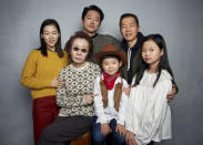 """FILE- Han Yeri, back row from left, Steven Yeun, director Lee Isaac Chung, and foreground from left, Yuh Jung Youn, Alan Kim, and Noel Cho pose for a portrait to promote the film """"Minari"""" during the Sundance Film Festival in Park City, Utah on Jan. 27, 2020. (Photo by Taylor Jewell/Invision/AP, File)"""