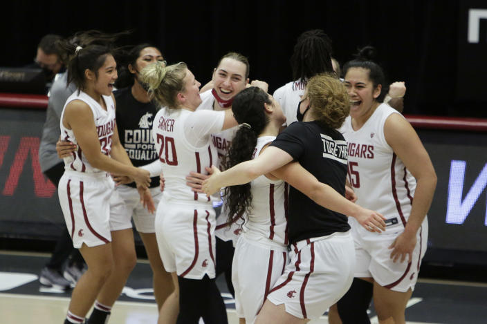 Washington State players celebrate their win over UCLA in an NCAA college basketball game in Pullman, Wash., Friday, Feb. 5, 2021. (AP Photo/Young Kwak)