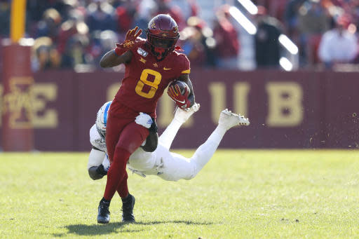 Iowa State wide receiver Deshaunte Jones, left, runs for a first down as Kansas safety Davon Ferguson makes the tackle during the second half of an NCAA college football game, Saturday, Nov. 23, 2019, in Ames, Iowa. Iowa State won 41-31. (AP Photo/Matthew Putney)