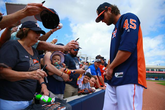 <p>Houston Astros pitcher Gerritt Cole signs for fans before the baseball game against the Minnesota Twins at the Ballpark of the Palm Beaches in West Palm Beach, Fla., on Feb. 28, 2018. (Photo: Gordon Donovan/Yahoo News) </p>