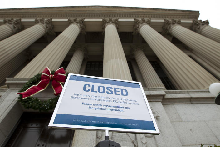 A closed sign is displayed at The National Archives entrance in Washington, Jan. 1, 2019, as a partial government shutdown stretches into its third week. A high-stakes move to reopen the government will be the first big battle between Nancy Pelosi and President Donald Trump as Democrats come into control of the House. (Photo: Jose Luis Magana/AP)