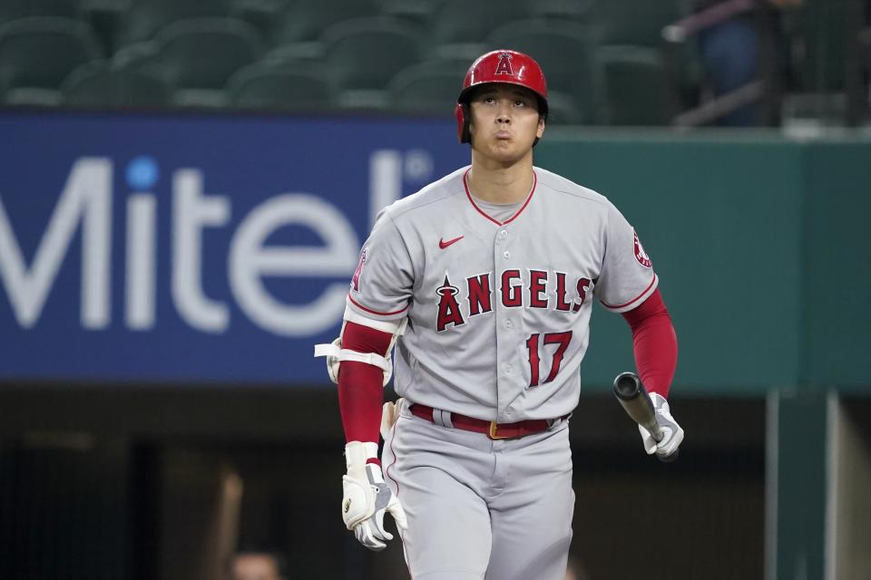 Los Angeles Angels' Shohei Ohtani walks back to the dugout after striking out in the first inning of the team's baseball game against the Texas Rangers in Arlington, Texas, Wednesday, Aug. 4, 2021. (AP Photo/Tony Gutierrez)
