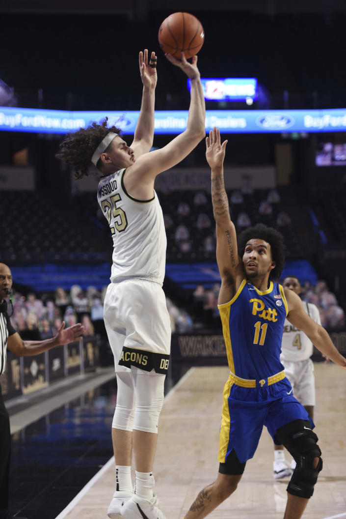 Wake Forest's Ismael Massoud shoots from 3-point range over Pittsburgh's Justin Champagnie during an NCAA college basketball game Saturday, Jan. 23, 2021, in Winston-Salem, N.C. (Walt Unks/The Winston-Salem Journal via AP)