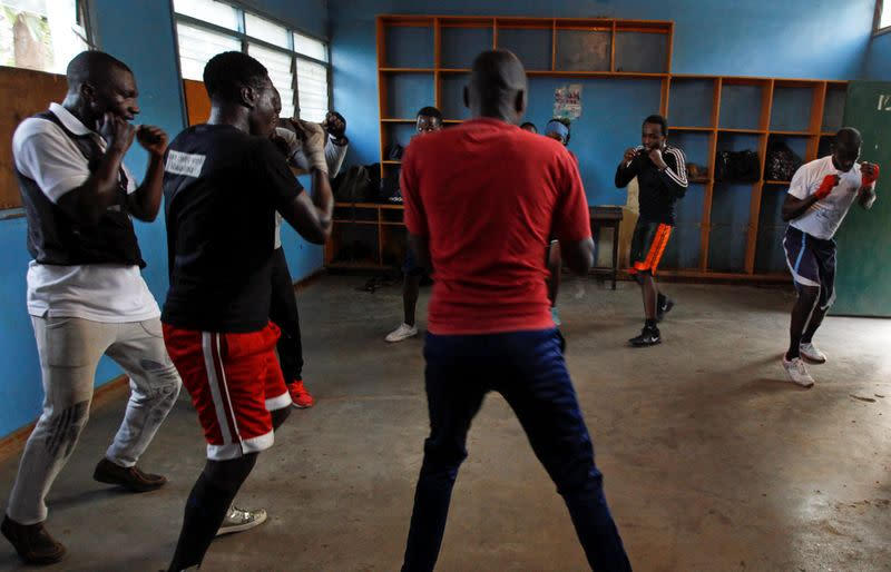 Blending law and boxing sport to reduce criminal activities and police brutality in slum areas