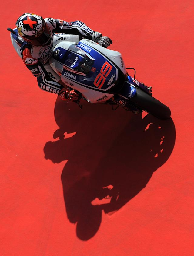 Yamaha Factory Racing's Spanish Jorge Lorenzo rides at the Catalunya racetrack in Montmelo, near Barcelona, on June 1, 2012, during the MotoGP first training session the Catalunya Moto GP Grand Prix. AFP PHOTO/LLUIS GENE.LLUIS GENE/AFP/GettyImages