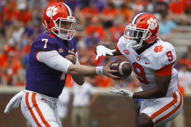 Apr 6, 2019; Clemson, SC, USA; Clemson Tigers quarterback Chase Brice hands the ball off to running back Travis Etienne (9) during the first half of the spring game at Clemson Memorial Stadium. Mandatory Credit: Joshua S. Kelly-USA TODAY Sports