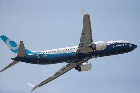 FILE PHOTO: A Boeing 737 Max takes part in flying display at the 52nd Paris Air Show at Le Bourget Airport near Paris
