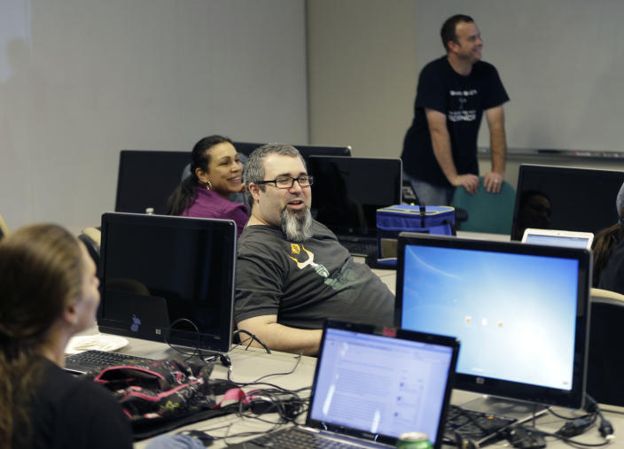 "In this Thursday, July 18, 2013, photo, Kyle Maxwell, center, talks shares a laugh with others during a monthly Cryptoparty in Dallas. Across the Internet, users are talking about changes small and large, from using more encryption and stronger passwords to much more extreme measures such as ditching cellphones and using cash over credit cards. The conversations play out daily on Reddit, Twitter and other networks, and have spread to offline life with so-called ""Cryptoparty"" gatherings in cities including Dallas, Atlanta and Oakland, Calif. (AP Photo/LM Otero)"