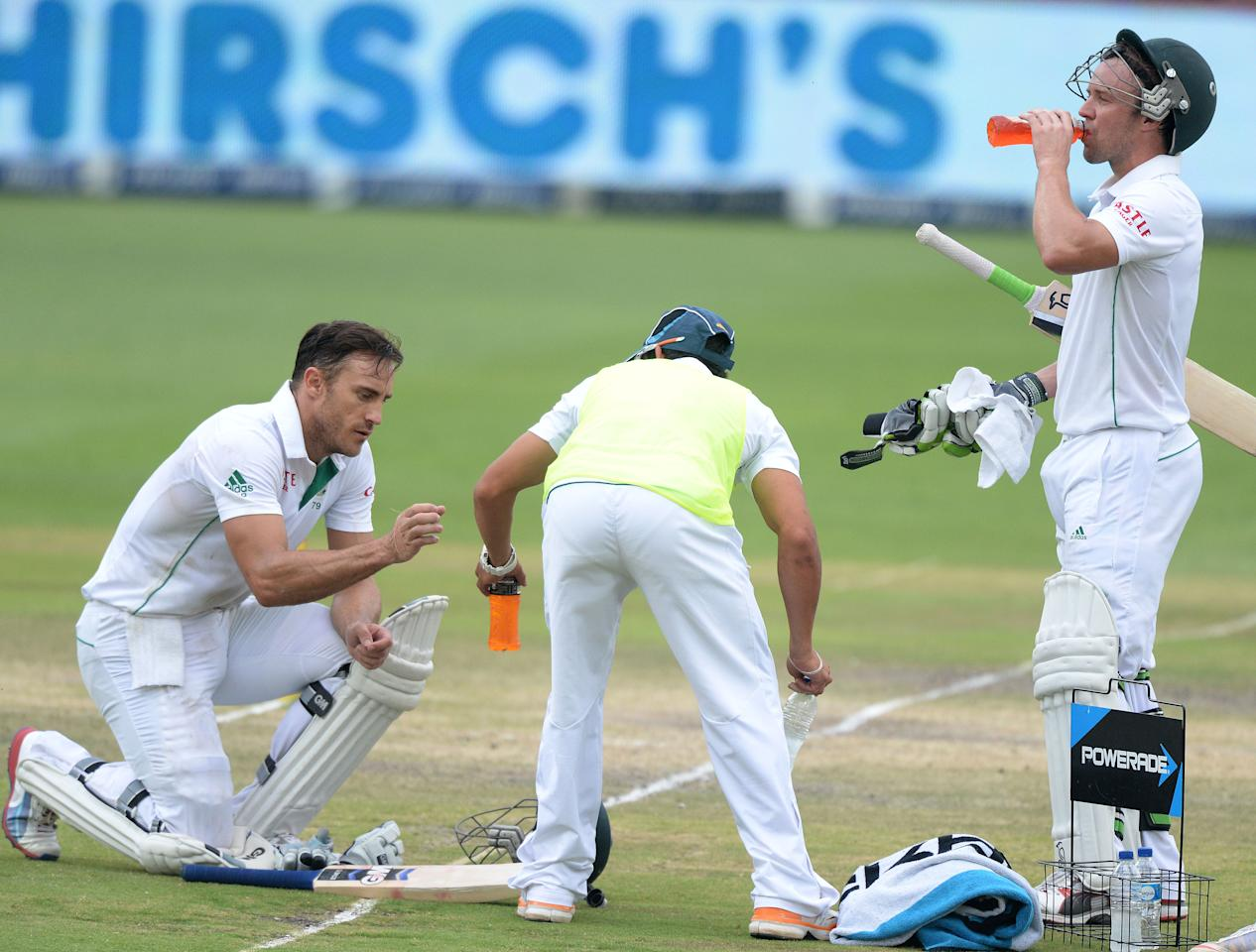 JOHANNESBURG, SOUTH AFRICA - DECEMBER 22: Faf du Plessis and AB de Villiers during day 5 of the 1st Test match between South Africa and India at Bidvest Wanderers Stadium on December 22, 2013 in Johannesburg, South Africa. (Photo by Duif du Toit/Gallo Images)