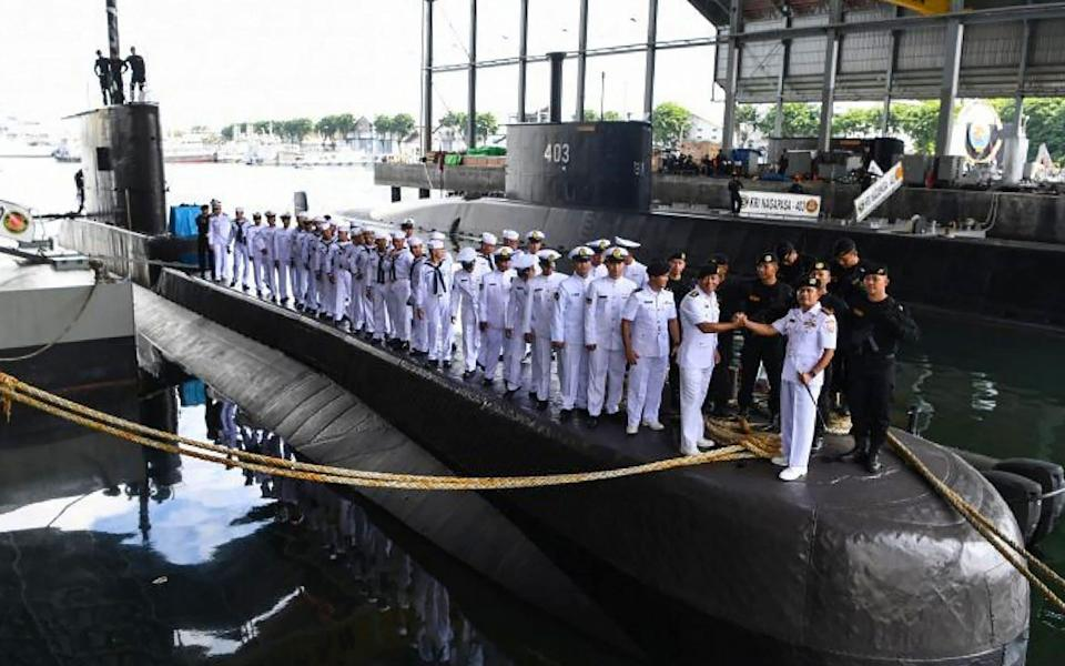 This handout from the Indonesia military taken on February 20, 2019 and released on April 21, 2021 shows the crew and officers during a ceremony onboard the Indonesian Cakra class submarine KRI Nanggala - AFP