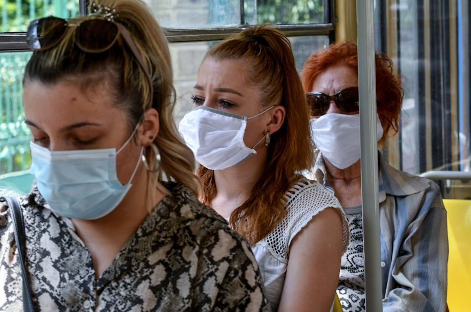 Passengers travel wearing facemasks on a tram in Zagreb on June 25, 2020, as the wearing of masks on public transport in Croatia became mandatory on June 23, due to an increase of coronavirus infections after the relaxation of lockdown conditions. (Photo by DENIS LOVROVIC / AFP) (Photo by DENIS LOVROVIC/AFP via Getty Images)