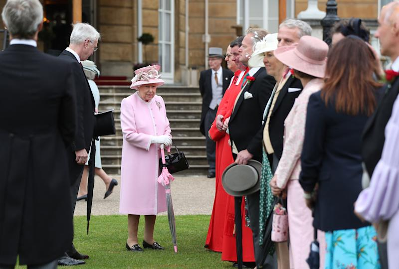 Britain's Queen Elizabeth II greets guests at the Queen's Garden Party in Buckingham Palace, central London on May 29, 2019. (Photo by Yui Mok / POOL / AFP) (Photo credit should read YUI MOK/AFP via Getty Images)