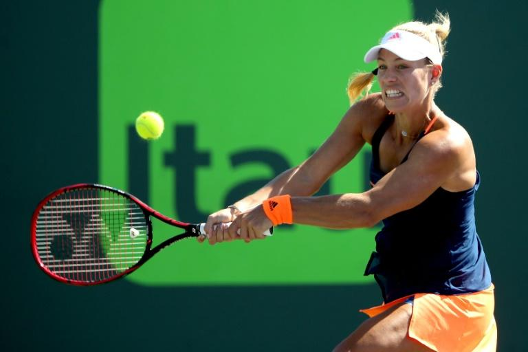Angelique Kerber of Germany returns a shot to Risa Ozaki of Japan during their Miami Open 4th round match, at the Crandon Park Tennis Center in Key Biscayne, Florida, on March 27, 2017
