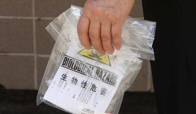 The authorities have assured the public that sample bottles would only carry serial numbers and no personal data. Photo: K. Y. Cheng