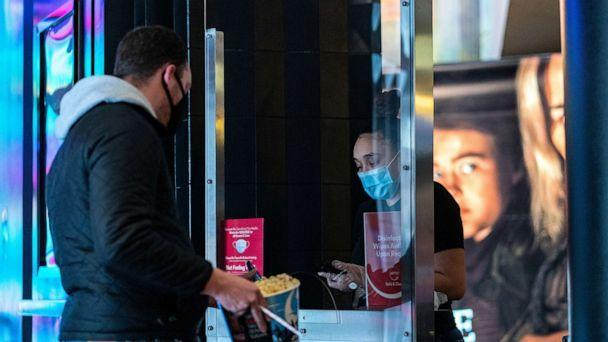 PHOTO: A staff wearing a protective mask works at the AMC movie theatre in Lincoln Square, amid the COVID-19 pandemic, in New York, March 6, 2021. (Jeenah Moon/Reuters)