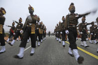 Indian army soldiers march during rehearsals for the upcoming Republic Day parade at the Raisina hills, the government seat of power, in New Delhi, India, Monday, Jan. 18, 2021. Republic Day marks the anniversary of the adoption of the country's constitution on Jan. 26, 1950. Thousands congregate on Rajpath, a ceremonial boulevard in New Delhi, to watch a flamboyant display of the country's military power and cultural diversity. (AP Photo/Manish Swarup)