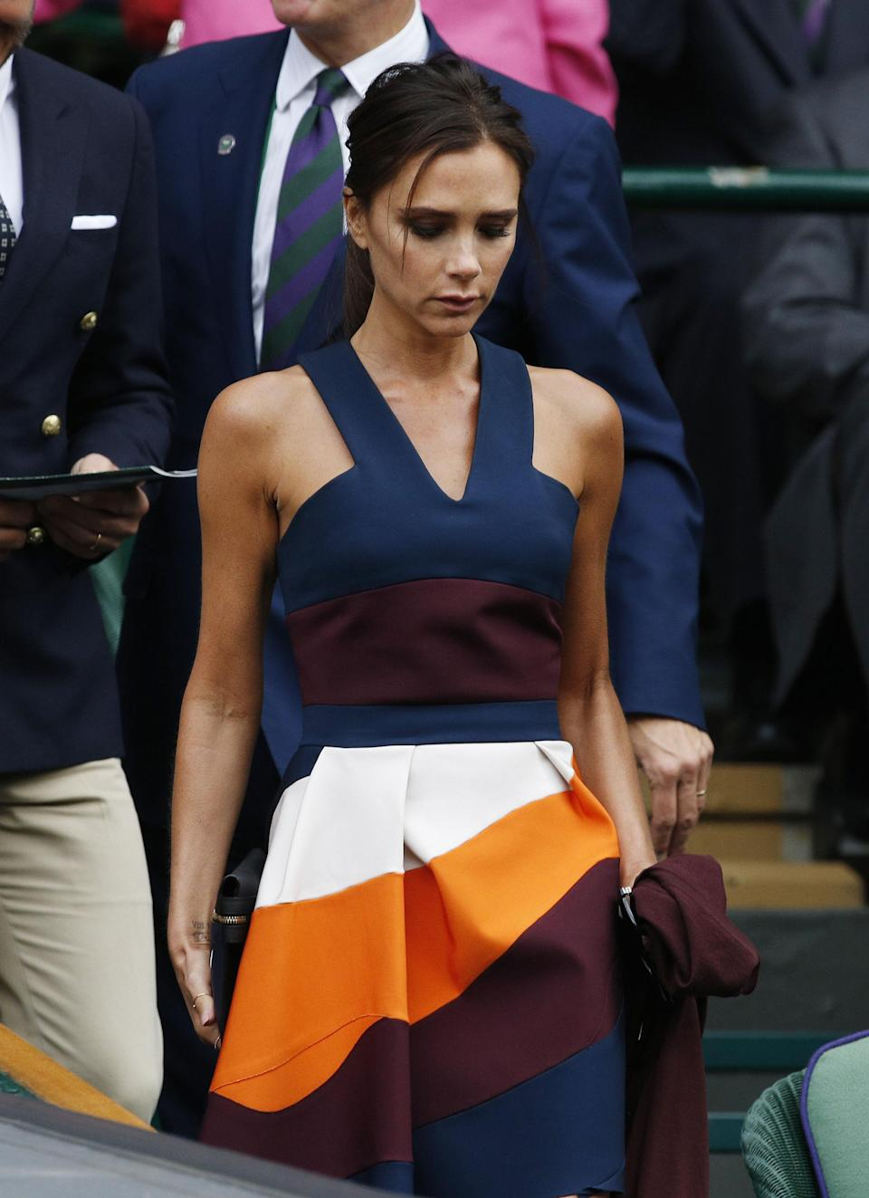 Victoria Beckham wearing one of her own designs to Wimbledon in 2014 [Photo: Getty]