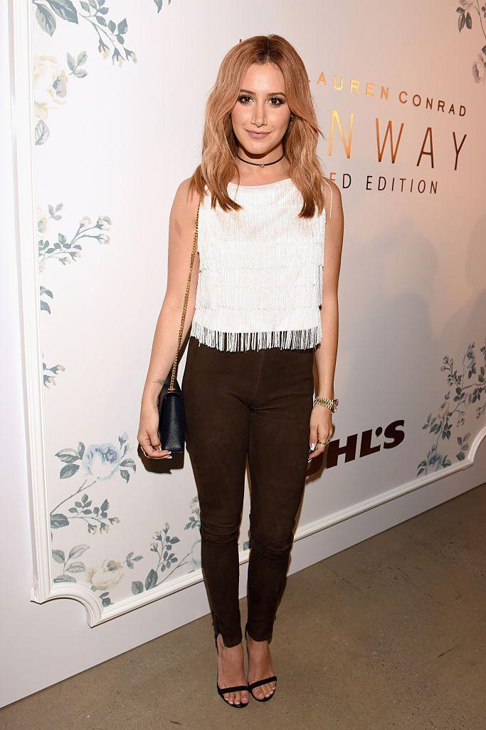 <p>If you want peach locks that are slightly more natural-looking, try a darker variation of the shade. <strong>Ashley Tisdale</strong> keeps her roots dark to bring it even more down to earth. </p>