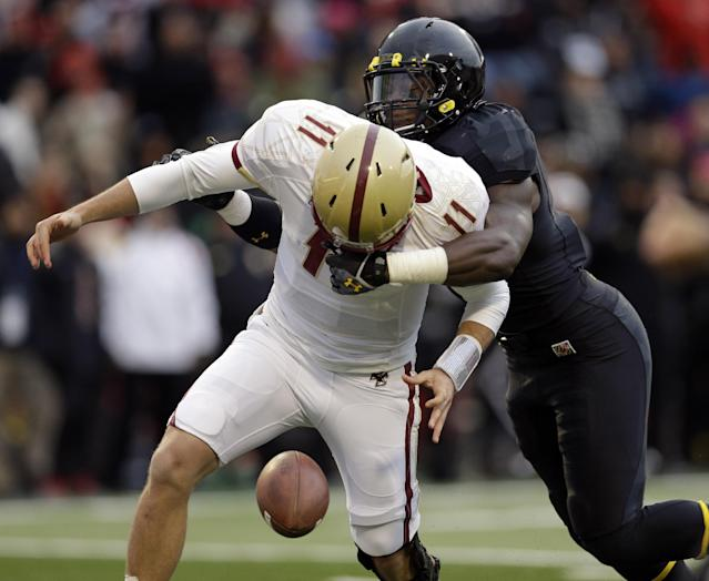 Maryland linebacker Marcus Whitfield, right, tackles Boston College quarterback Chase Rettig who fumbled the ball in the first half of an NCAA college football game in College Park, Md., Saturday, Nov. 23, 2013. Maryland gained possession on the play. (AP Photo/Patrick Semansky)