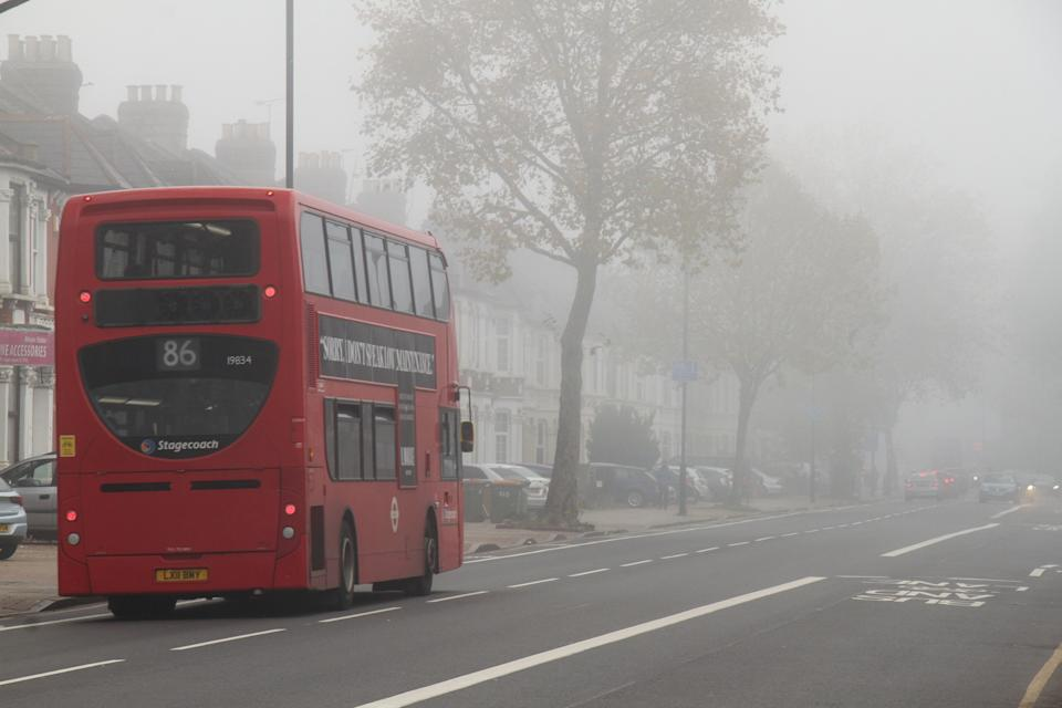 LONDON, UNITED KINGDOM - 2020/11/05: A London red bus passing through the fog on Romford Road in the morning. (Photo by David Mbiyu/SOPA Images/LightRocket via Getty Images)