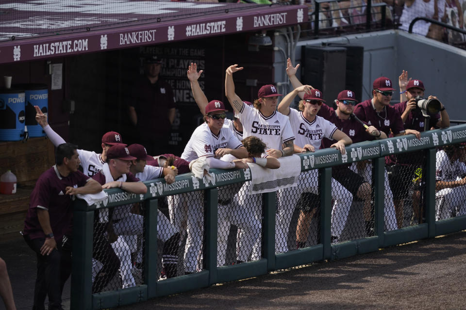 Mississippi State players shout encouragement during an NCAA college baseball super regional game against Notre Dame, Saturday, June 12, 2021, in Starkville, Miss. Mississippi State won 9-8. (AP Photo/Rogelio V. Solis)