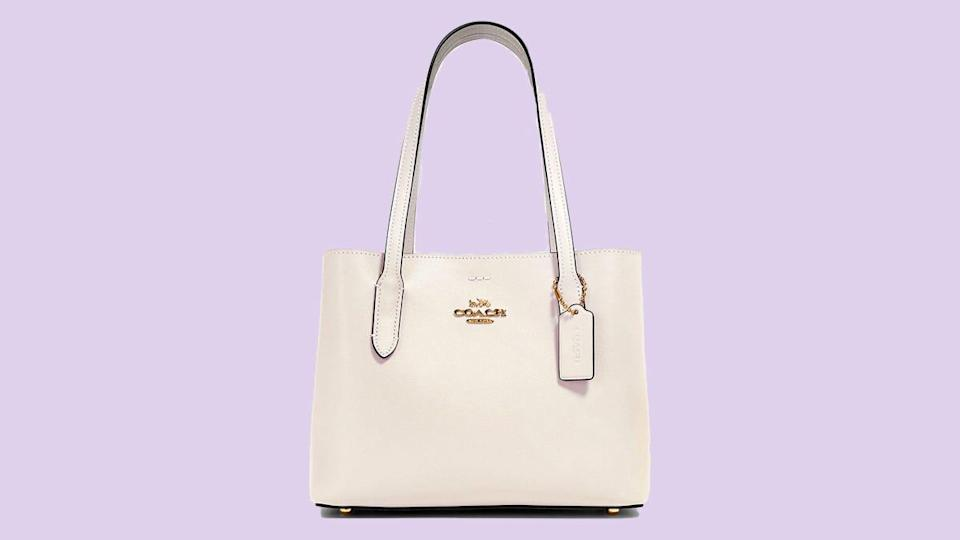 This refined leather carryall is a versatile wardrobe piece.