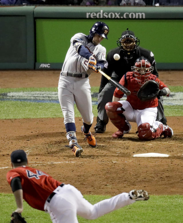Houston Astros' Josh Reddick hits a home run against the Boston Red Sox during the ninth inning in Game 1 of a baseball American League Championship Series on Saturday, Oct. 13, 2018, in Boston. (AP Photo/Elise Amendola)