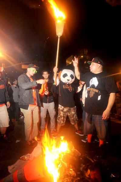 San Francisco Giants fans celebrate outside PacBell Park on Sunday, Oct. 28, 2012, in San Francisco after the Giants swept baseball's World Series against the Detroit Tigers. (AP Photo/Noah Berger)