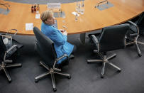 German Chancellor Angela Merkel arrives for the Wirecard investigation committee in Berlin, Germany, Friday, April 23, 2021. She has been summoned as a witness because she spoke up for Wirecard during a trip to China in September 2019. The 3rd Bundestag Investigative Committee is to investigate the conduct of the German government and the authorities under it in connection with the events surrounding the now insolvent financial services provider Wirecard. (Michael Kappeler/AP via Pool)