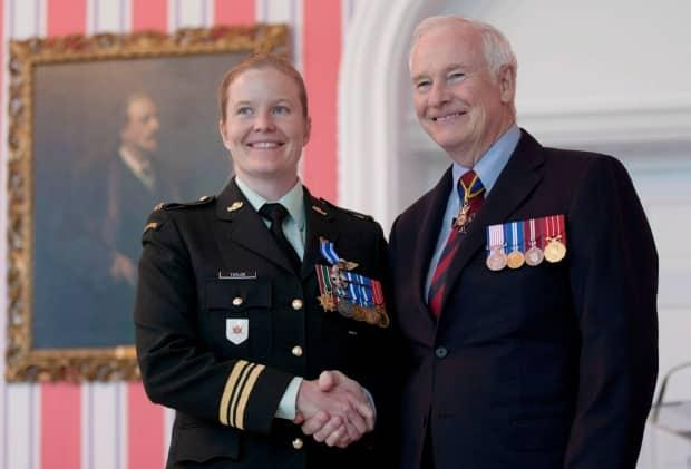 Governor General David Johnston presents then-Major Eleanor Taylor with the Meritorious Service Medal in Ottawa on June 22, 2012. (Adrian Wyld/The Canadian Press - image credit)