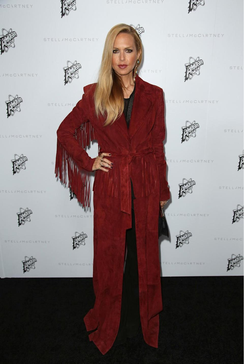 <p>Stylist-to-the-stars Zoe donned a wow-factor suede jacket, complete with fringing. <i>[Photo: Rex]</i></p>