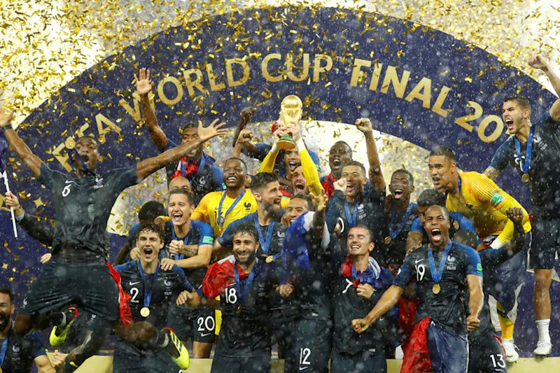 Hugo Lloris lifts the trophy as France celebrate after winning the World Cup. (REUTERS)