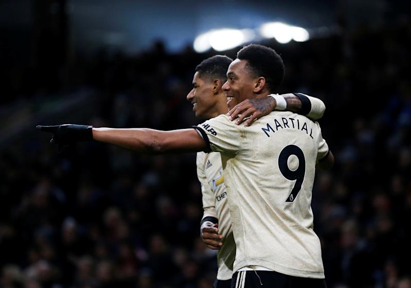 "Soccer Football - Premier League - Burnley v Manchester United - Turf Moor, Burnley, Britain - December 28, 2019 Manchester United's Anthony Martial celebrates scoring their first goal with Marcus Rashford Action Images via Reuters/Craig Brough EDITORIAL USE ONLY. No use with unauthorized audio, video, data, fixture lists, club/league logos or ""live"" services. Online in-match use limited to 75 images, no video emulation. No use in betting, games or single club/league/player publications. Please contact your account representative for further details."