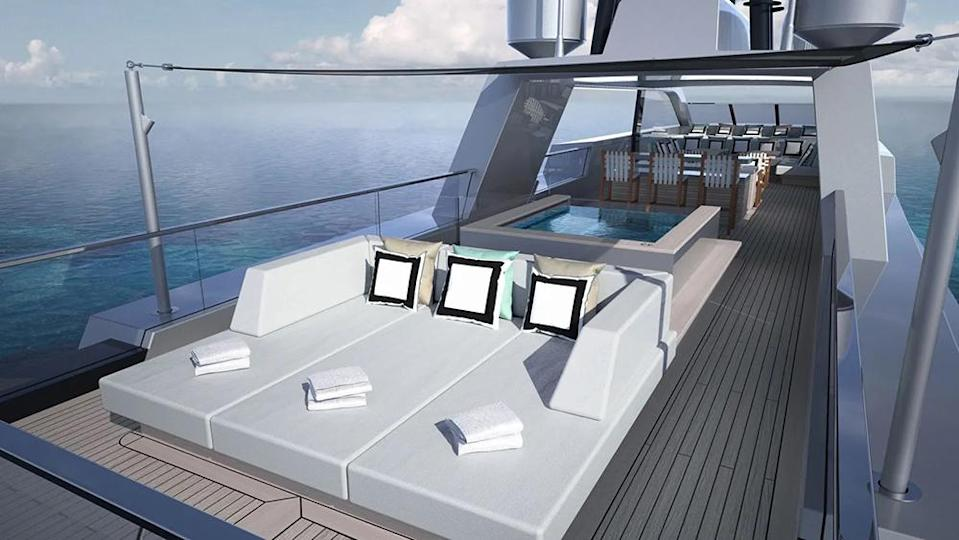 The sun deck features a Jacuzzi and alfresco dining area. - Credit: SilverYachts