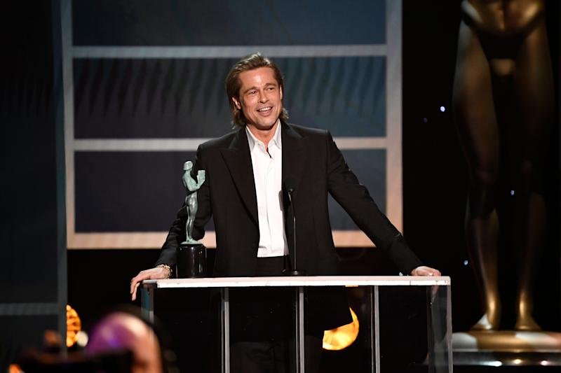"""Brad Pitt accepts the award for outstanding performance by a male actor in a supporting role for his role as Cliff Booth in """"Once Upon a Time in Hollywood"""" during the 26th Annual Screen Actors Guild Awards."""