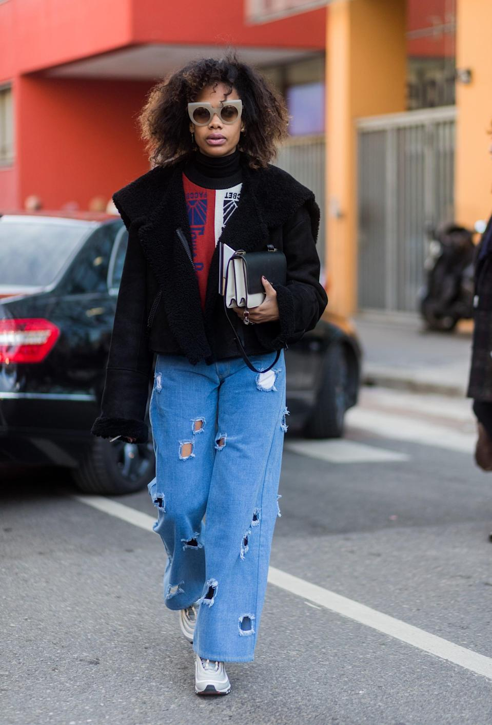 <p>Distressed cut-out details and chunky sneakers make for a total fashion-girl look. </p>