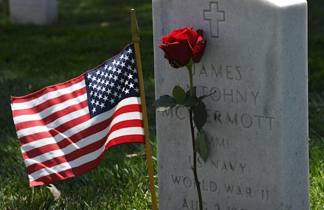 <p>American flags and flowers placed by volunteer groups are seen at the Los Angeles National Military Cemetery two days before Memorial Day in Los Angeles, Calif., on May 26, 2018. (Photo: Mark Ralston/AFP/Getty Images) </p>