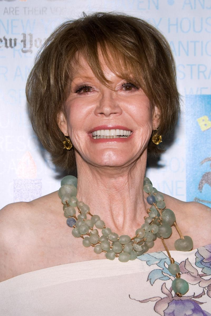 "FILE - In this July 11, 2009 file photo, actress Mary Tyler Moore attends Broadway Barks 11 in New York. A representative for Mary Tyler Moore says the veteran sitcom star is ""recovering nicely"" after surgery to remove a benign tumor on the lining of her brain. Spokeswoman Erica Tarin said Friday, May 13, 2011, Moore will require no additional treatment after the four-hour procedure.  (AP Photo/Charles Sykes, file)"