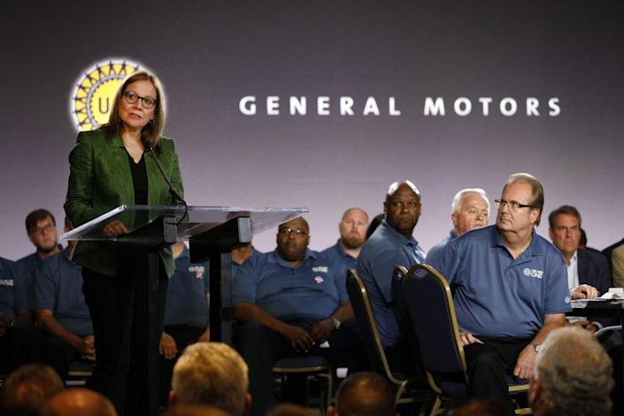 General Motors Chairman and CEO Mary Barra speaks while and United Auto Workers President Gary Jones (right) listens before they opened the 2019 GM-UAW contract talks with the traditional ceremonial handshake on July 16, 2019 in Detroit, Michigan. With its increasing investment in electric vehicles, GM is faced with the challenge of transitioning its employees to work with new technologies. (Photo by Bill Pugliano/Getty Images)