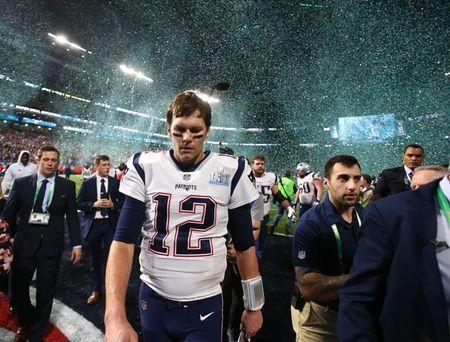 Feb 4, 2018; Minneapolis, MN, USA; New England Patriots quarterback Tom Brady (12) walks off the field after Super Bowl LII against the Philadelphia Eagles at U.S. Bank Stadium. Mark J. Rebilas-USA TODAY Sports