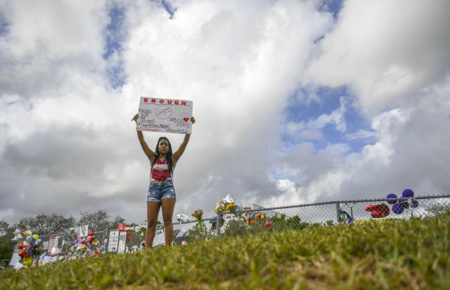A student at Marjory Stoneman Douglas High School, where 17 students and teachers were killed in a February 14th shooting, protests in support of gun laws. (Photo: Getty Images)