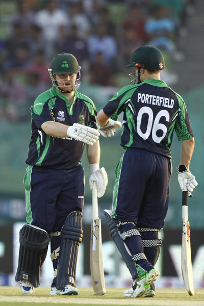 Ireland batsman Paul Stirling, left, celebrates with his captain William Porterfield after playing a boundary shot during their ICC Twenty20 Cricket World Cup match against Zimbabwe in Sylhet, Bangladesh, Monday, March 17, 2014. (AP Photo/A.M. Ahad)