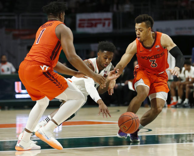 Miami guard Chris Lykes, center, loses control of the ball Virginia Tech guards Isaiah Wilkins (1) and Wabissa Bede (3) defend during the first half of an NCAA college basketball game Wednesday, Jan. 30, 2019, in Coral Gables, Fla. (AP Photo/Wilfredo Lee)