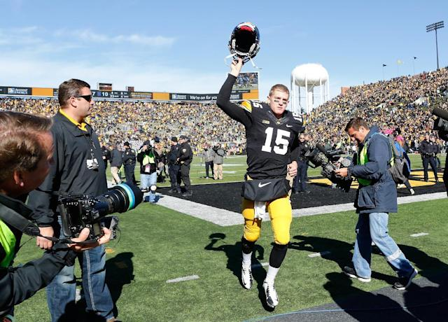 Iowa quarterback Jake Rudock (15) celebrates as he runs off the field following the team's 17-10 overtime victory over the Northwestern in an NCAA college football game Saturday, Oct. 26, 2013 at Kinnick Stadium in Iowa City, Iowa. (AP Photo/Brian Ray)