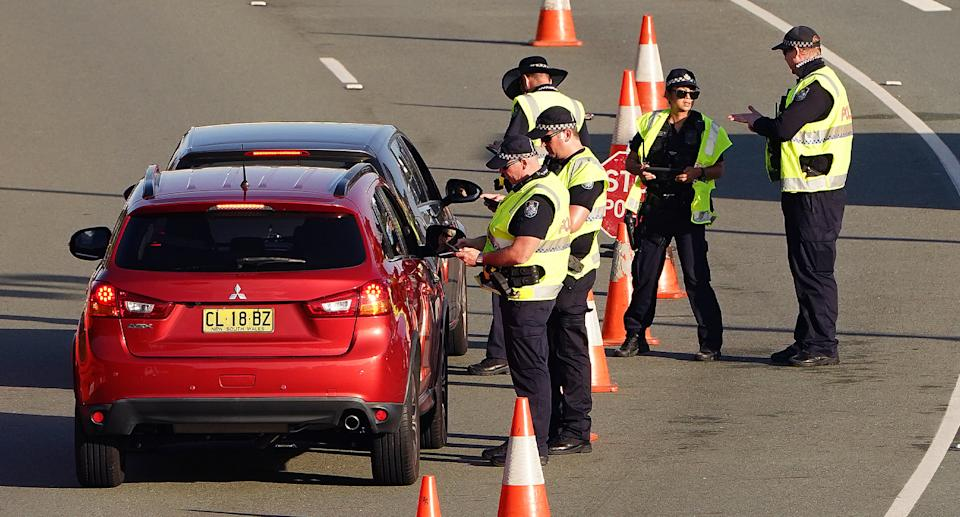 Queensland Police carrying out border checks on cars entering the state. Source: Getty