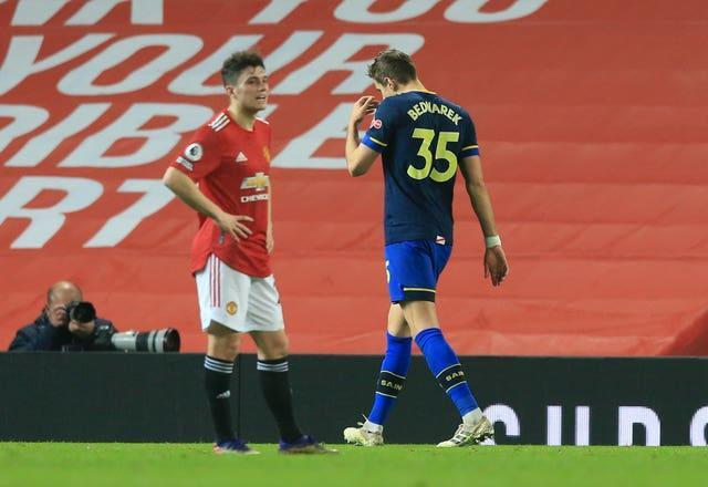 Jan Bednarek (right) was given his marching orders on a dismal night for Southampton at Old Trafford
