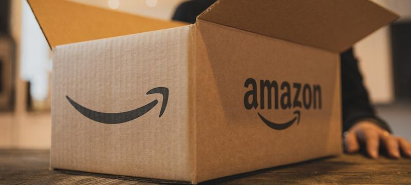 An open Amazon box sitting on a table.