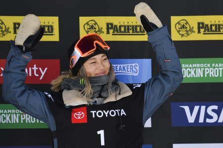 Gold medalist Chloe Kim, of the United States, celebrates after winning the women's snowboard halfpipe final at the freestyle ski and snowboard world championships