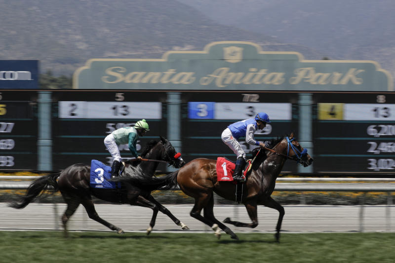 Eddie Haskell, right, with jockey Kent Desormeaux aboard, win the third race during the last day of the winter/spring meet at the Santa Anita horse racing track Sunday, June 23, 2019, in Santa Anita , Calif. (AP Photo/Chris Carlson)