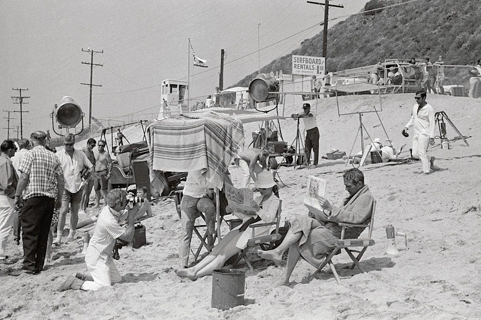 <p>Paul Newman and his wife, Joanne Woodward, sit in beach chairs and read the paper between takes on the set of <em>Winning. </em>What a life.</p>